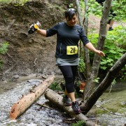 Lulu Guerrero crosses a creek during the 2013 Red Devil Challenge.