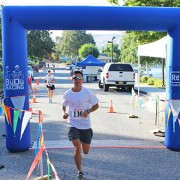 Andy Johnson crosses the finish line in Manson to win the 2012 Shore to Shore Half-Marathon title in 1 hour, 24 minutes and 31 seconds.