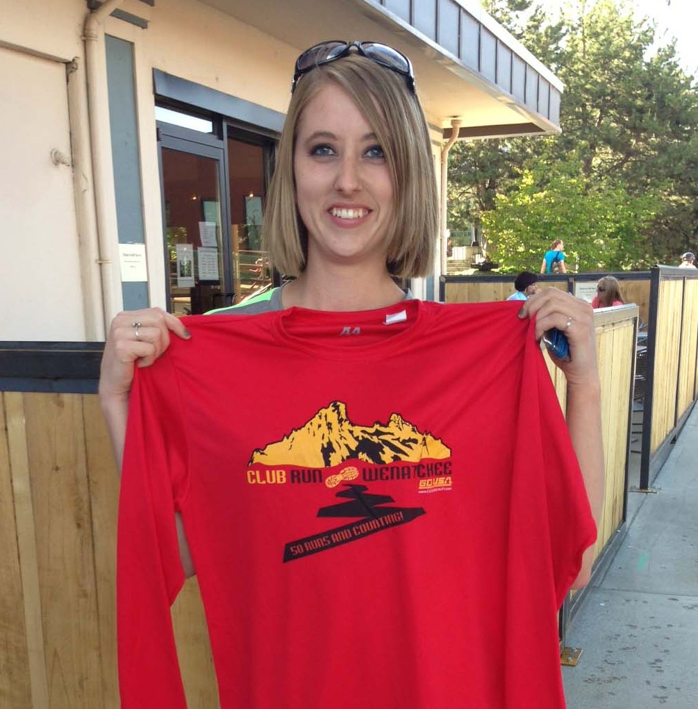 Tianna Sandhop shows off the club run commemorative shirt she received after completing her 50th weekly run.