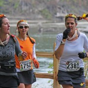 Three runners in Saturday's Leavenworth Oktoberfest Marathon and Half-Marathon traverse the Waterfront Park area along the Wenatchee River.