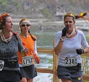 Three runners in Saturday's Leavenworth Oktoberfest Marathon and Half-Marathon traverse the Waterfront Park area along the Wenatchee River.