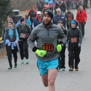 Men's 12K winner Taij Corso of East Wenatchee runs along Woodward Avenue on his way to the finish line in Rotary Park.