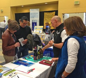 Joel and Michele Rhyner staffed the RunWenatchee booth at the 2014 Wenatchee Marathon Health & Fitness Expo at the Wenatchee Convention Center.