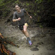 Sarah Barkley flies through the creek bottoms on the way to her 25K women's title Sunday at Red Devil.