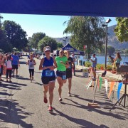 Shore to Shore runners cross the finish line in Manson.
