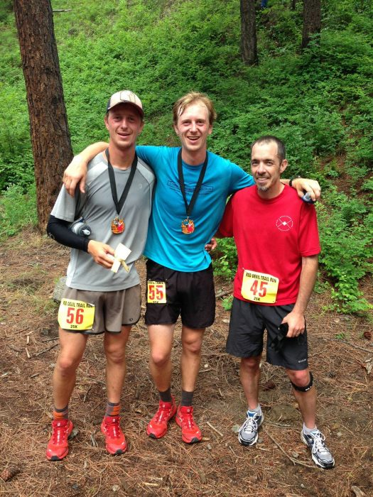 Cyrus Desmarais, left, his brother, Niles, center, and Barry Hodges, right, gather after the Red Devil 25K Trail Run in May. The Desmarais brothers tied for first and Hodges took third in the trail race south of Cashmere.