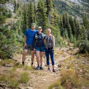 Marlene Farrell, with her husband and a friend, pose for a photo whiel running from the Ingalls Creek Trail Head to the Jack Creek Trail Head in the Cascades.